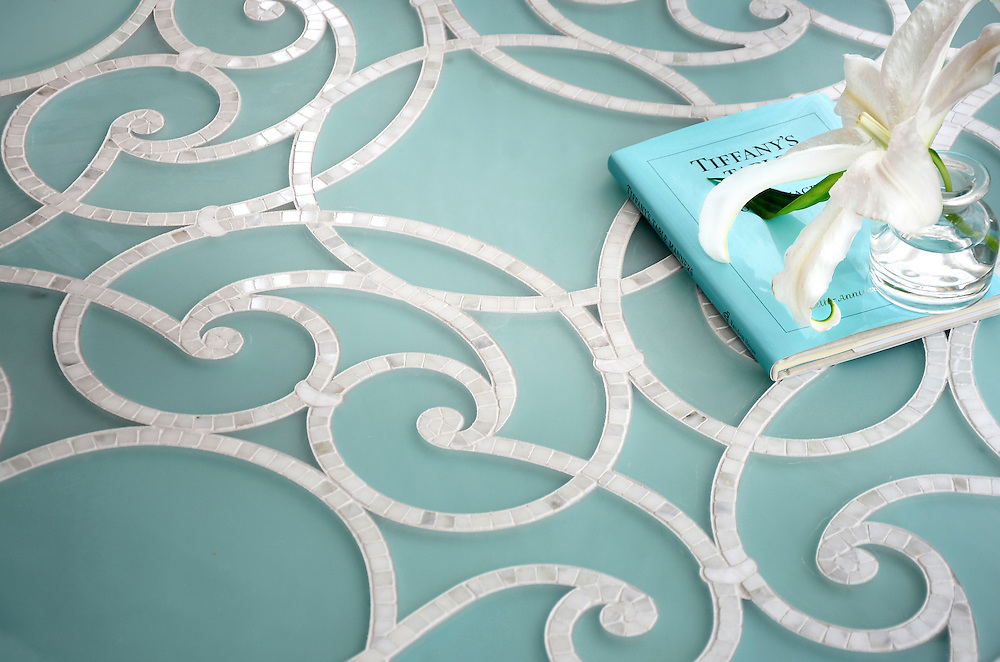 Abigail, a stone mosaic and glass water jet mosaic, shown in Aquaberyl glass honed and Calacatta polished.
